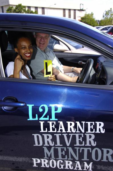 Mentor Peter Sutton with learner driver Hawi Yadessa. 113590 Picture: DONNA OATES