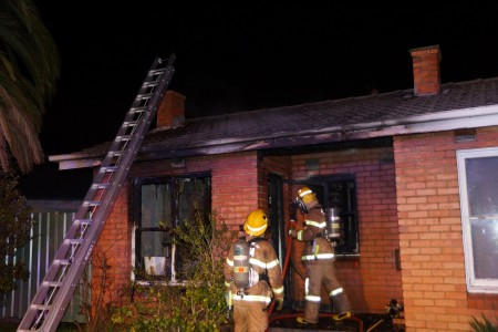 Firefighters battle a house fire in Dandenong earlier this month.