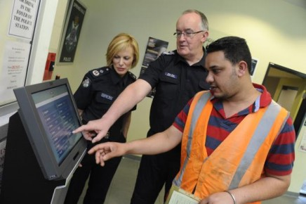 Deputy Commissioner Lucinda Nolan, Senior Sergeant Alan Dew and local resident Harmandeep  trial the kiosk in Hindi. 130464 Picture: STEWART CHAMBERS