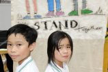 Vinh and Helena stand together against bullying. 162082 Picture: STEWART CHAMBERS