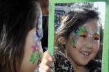 Kawsar reflects on her colourful face painting. 136132