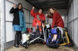 Sri Samy, Elaine Smith and volunteer Melissa Grenville load the new Friends of Refugees truck. 139395 Picture: STEWART CHAMBERS