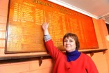 Elena Sheldon with the honour roll recognising SLAC contributors from as far back as 1945. 143465 Picture: ROB CAREW
