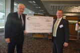 Laurie Leeman accepts a cheque from Roy Sanderson. 147589