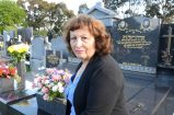 Councillor Maria Sampey at her son Paul's grave.